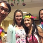Happy Community Life Team with their colorful Luau outfits posing for this annual celebration.