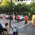 Residents experiencing how to Hula dance with the experts.