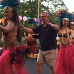 A family member enjoying his time dancing with the beautiful hula dancers.