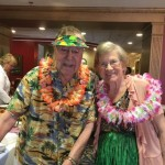 Wonderful couple in their traditional Hawaiian outfits enjoying the social event.