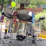 One man steel drum band performing his Calypso music to entertain during the event.