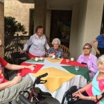 Residents enjoying their tropical drinks during the social event.
