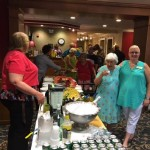 Residents and associates having fun socializing and assisting others during the mix and mingle