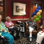 Residents and family members socializing in the lobby.