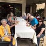 Washington House residents having a great time outdoors with their appetizers, drinks and socializing.