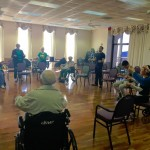 NOVA Physical Therapy Students explaining to the residents the next fitness exercise.