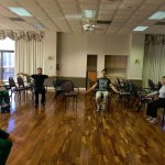NOVA Therapy Students demonstrating more fitness moves while explaining to the residents the proper way to do it.