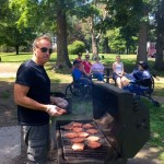Chef Chris making sure to grill the hotdogs and hamburgers to perfection.