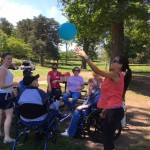 Associates engaging the residents during balloon volleyball.
