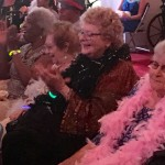 Residents cheering and clapping during the Diva show