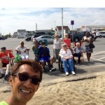 Taking a selfie with the residents who were relaxing with the ocean breeze.