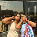 A resident and her daughter having a great time looking at the solar eclipse.