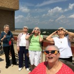Residents getting excited watching the eclipse.