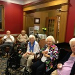 Residents enjoying their beverage while listening to the music.
