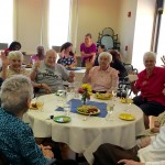 Residents having a great time during the Island themed Mix and Mingle social.