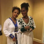 Associates wearing one of their traditional outfits - Habesha Dress.