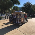 Residents enjoying their shuttle golf cart ride heading to the entrance to the U.S. Capitol Visitor Center.