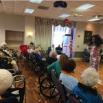 Shi-Queeta Lee as Diana Ross welcoming the residents and guests.
