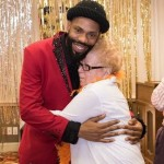 Marvin Gaye impersonator hugging a resident during his performance.