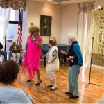 Shi-Queeta Lee as Tina Turner teaching a couple residents to dance to the music of Proud Mary.