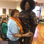 Chaka Khan impersonator dancing with a resident.