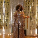 Whitney Houston impersonator serenading the crowd.