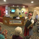 More residents having a great time with the accordionist.