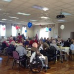 A crowded Sky Room during our Veterans Day event