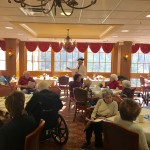 Our volunteer leading the residents in some Hanukkah singing.