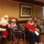 Santa singing holiday carols with our residents.