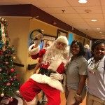 Associates at Washington House having a great time with Santa.
