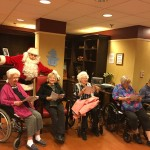 Santa socializing with our residents during our holiday community sing-along in The Springs.