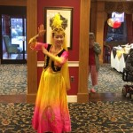 Costume change for another traditional Chinese dance performed during social event.