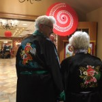 Residents showing their Asian embroidery of their Chinese robes.