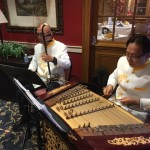 The Chinese Music Society musicians playing traditional Chinese music during social event.