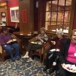 Residents enjoying the music and refreshments during social hour.