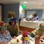 Residents in The Springs wearing their own hand made Mardi Gras masks for the event.