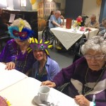 A few residents wearing their Mardi Gras mask for the event.