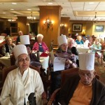 Residents wearing chef hats during the Culinary Concepts class.