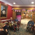 Residents enjoying themselves during social event.