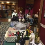Residents socializing in the main lobby during Mix and Mingle.