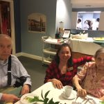 A couple residents in The Springs with our Community Life during social hour.
