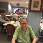 Residents in The Springs having fun during dinner time with French music and French cuisine.
