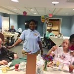 Associates in The Springs socializing with our residents during the social hour.