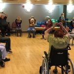 Residents getting fit through their stabilization endurance class with our fitness trainer.
