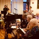 Patricia Dowd, one of the Skytones chorus member performing her solo piano rendition of the music Alouette.