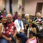 Residents having a great time during our main Luau Show.