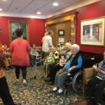 Ukulele player entertaining our residents during Mix and Mingle.