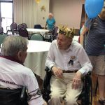 Our celebrant being greeted by residents and friends.