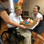 Our community life team helping out during the cake blowing and singing Happy Birthday to Fred.